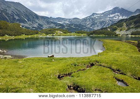 Panoramic view of Banderishki Chukar peak and reflection in Muratovo lake, Pirin Mountain