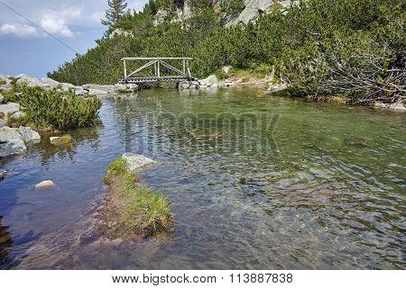Amazing view of Wooden bridge over River near Vihren hut, Pirin Mountain