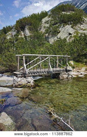 Amazing Landscape of Wooden bridge over River near Vihren hut, Pirin Mountain