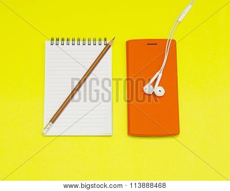 Music Player, Notebook With Pencil On Yellow Background