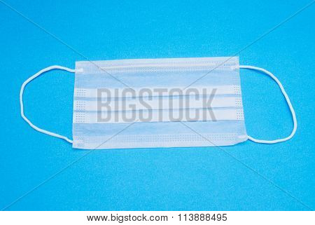 Surgical Ear-loop Mask On Blue Background