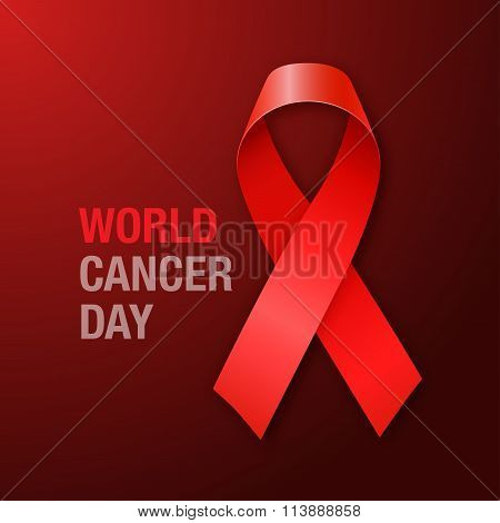 World Cancer Day. Red Ribbon on dark background