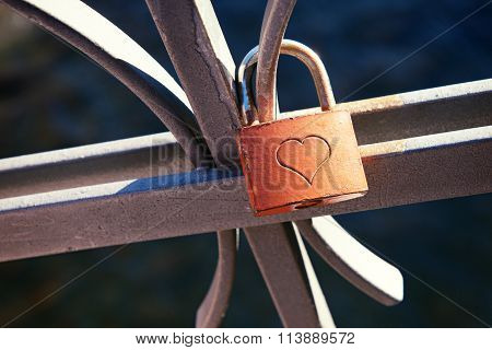 Love Lock Attached To A Metal Balustrade