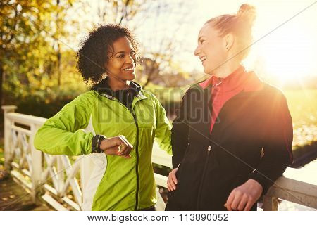 Two Young Women In Sportswear Smiling At Each Other