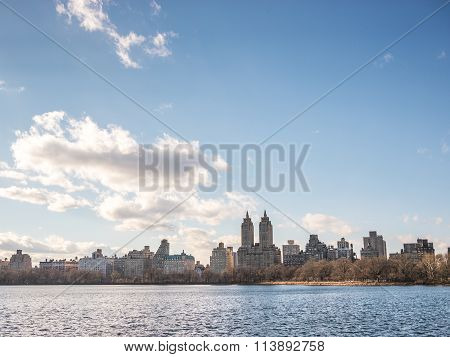 View of the New York city skyline over the Jackie Kennedy reservoir in Manhattan