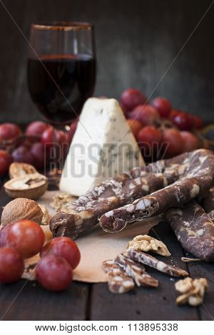 Snacks For Wine, Cheese With Mold, Pink Grapes, Walnuts And Jerked Dry Sausage