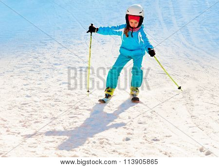 Girl Skiing At Ski Resort