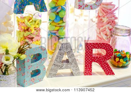 Sweet table as candy bar with different sweets on dinner or even