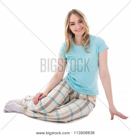 Young Beautiful Woman In Pajamas Sitting Isolated On White