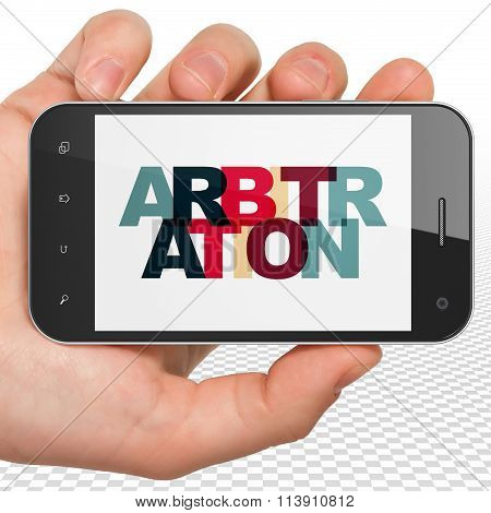Law concept: Hand Holding Smartphone with Arbitration on  display