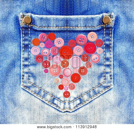 Blue Jeans With Pocket And Heart From Buttons Closeup