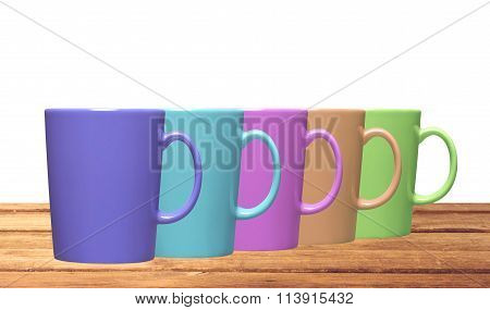 Set Of Colorful Teacups On Table Isolated On White Background