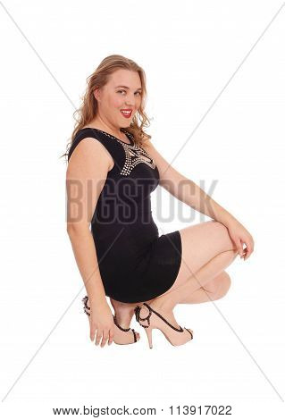 Smiling Woman Crouching On Floor.