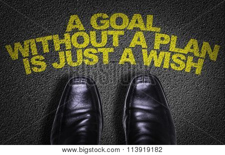 Top View of Business Shoes on the floor with the text: A Goal Without a Plan Is Just a Wish