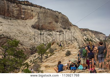 Hikers Enjoying The View On Top Of Angels Landing