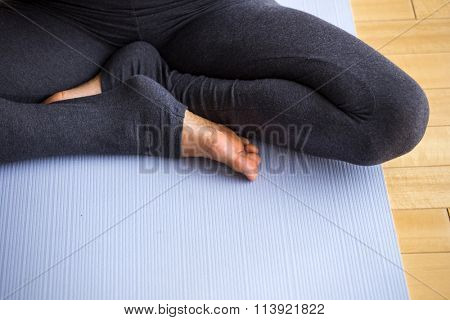 Young latin woman practicing meditation indoors.