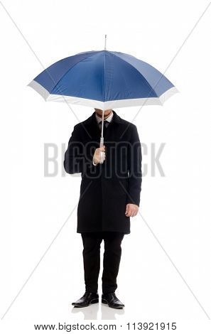Young man with umbrella isolated on white
