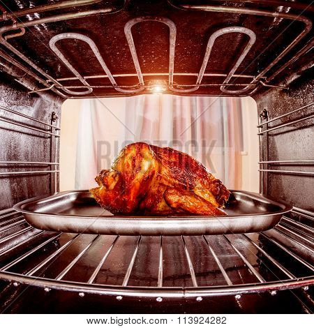 Roast chicken in the oven, view from the inside of the oven. Cooking in the oven.