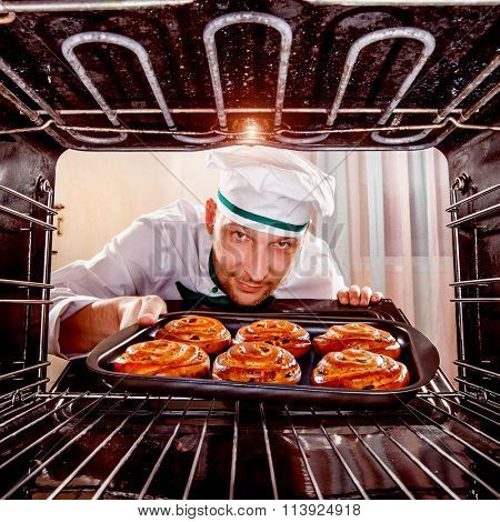 Chef prepares pastries in the oven, view from the inside of the oven. Cooking in the oven.