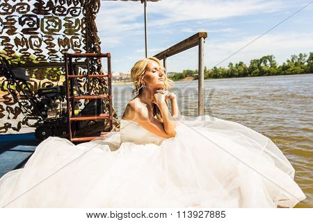bride sitting on the pier