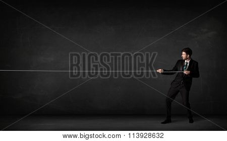 Businessman pulling rope on grey background concept