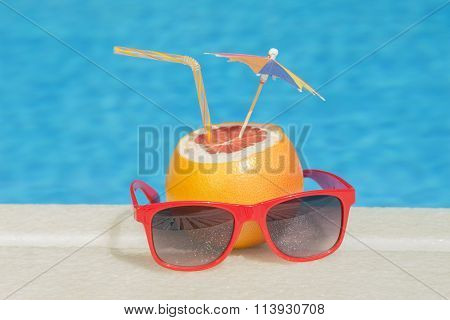 Grapefruit and sunglasses - poolside