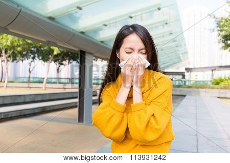 Asian Woman blowing into tissue