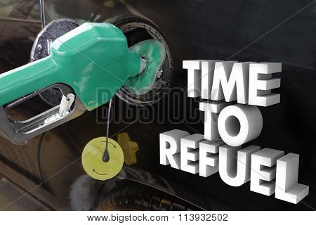 Time to Refuel words in 3d letters next to a gas nozzle filling a car or truck's gasonline tank with power