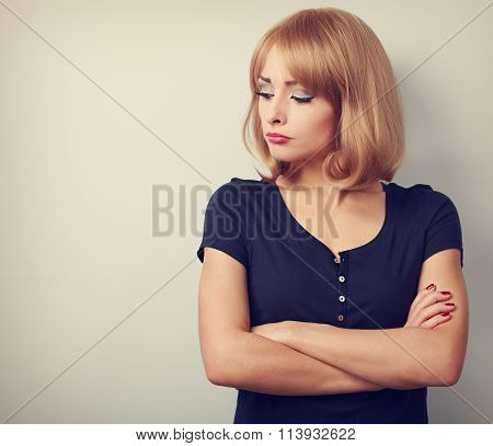 Resentful Unhappy Casual Woman With Short Blond Hair Looking Down