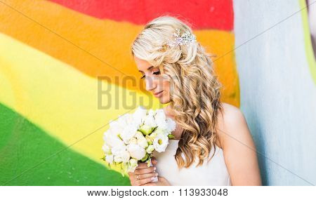 portrait of a happy bride holding flowers