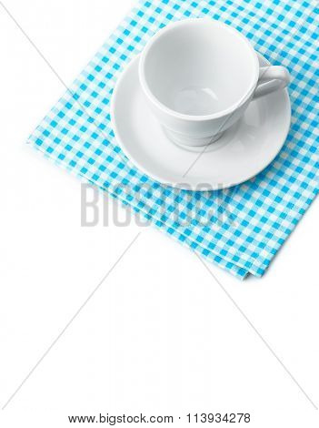 White porcelain mug with saucer tableware on cellular napkin. Isolated on white background