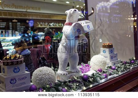 ST. PETERSBURG, RUSSIA - DECEMBER 27, 2015: Toy polar bear in the show window of the confectionery Sever. Founded in 1903, now the confectionery has more than 40 sweetshops in the city