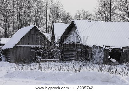the old wooden buildings covered with snow in winter