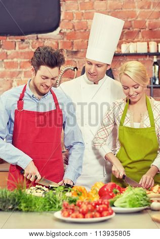 happy couple and male chef cook cooking in kitchen