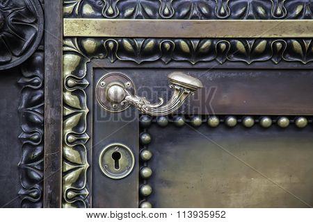 bronze metal antique door handle closeup