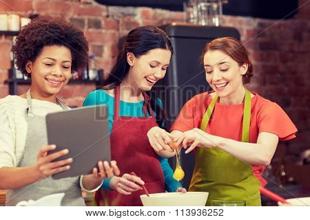 happy women with tablet pc in kitchen