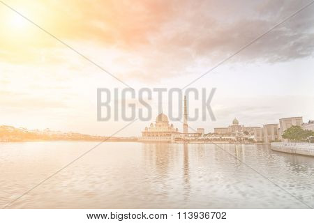 Landscape of mosque with river under blue sky in Putrajaya, Malaysia, Asia.