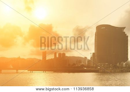 City silhouette with buildings shape in sunset in Macao, China.
