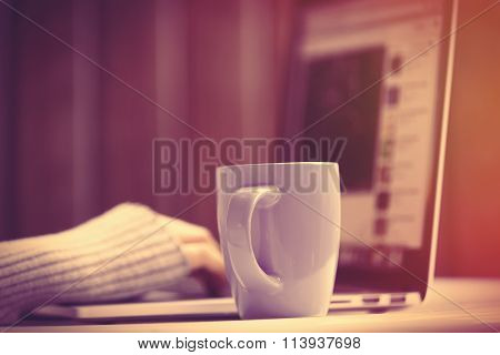 Woman Woking With Notebook Near A Cup