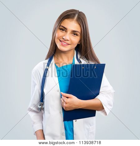 A female doctor standing isolated on gray background