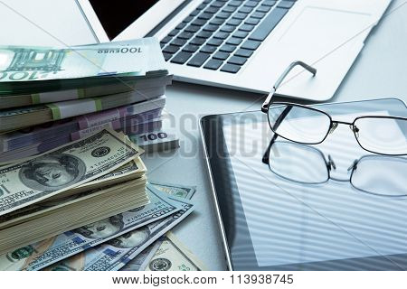 The workplace of business people. Laptop and money.