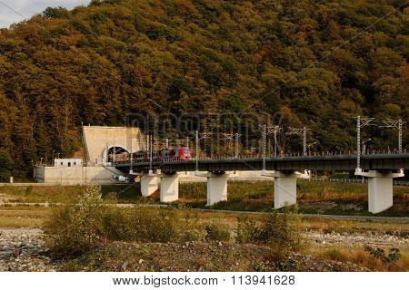 KRASNAYA POLYANA, SOCHI, RUSSIA - SEPTEMBER 30, 2015: High-speed train Lastochka on the mountain railroad. Produced by Siemens AG, the train can reach speeds up to 160 km/h