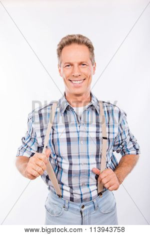 Confident Happy Aged Man In Suspenders Smiling