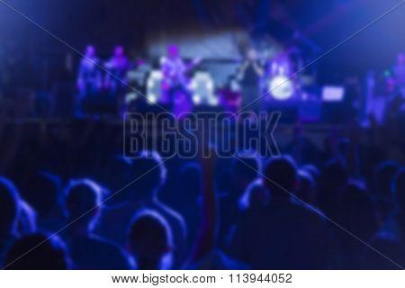 Rock band concert - defocused crowd and performers