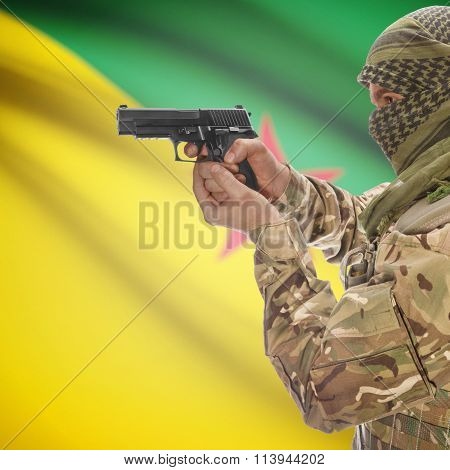Male In With Gun In Hand And National Flag On Background - French Guiana