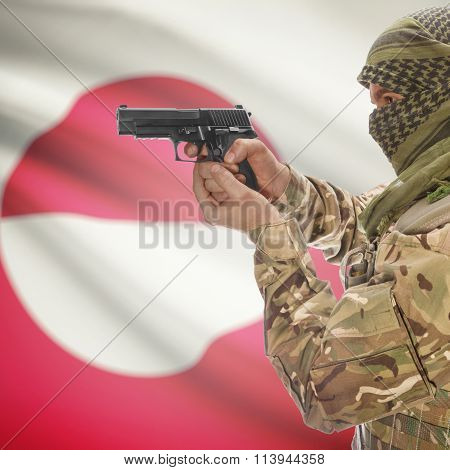 Male In With Gun In Hand And National Flag On Background - Greenland