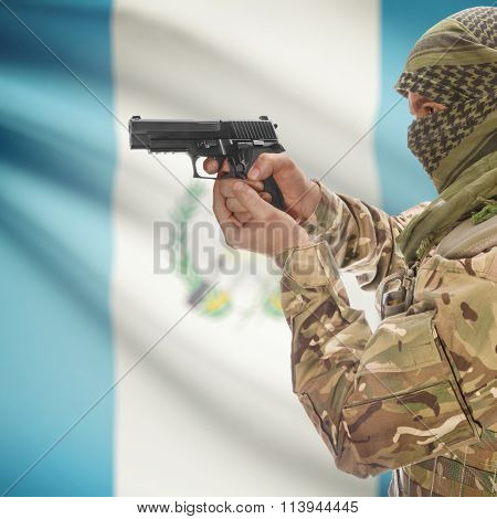 Male In With Gun In Hand And National Flag On Background - Guatemala