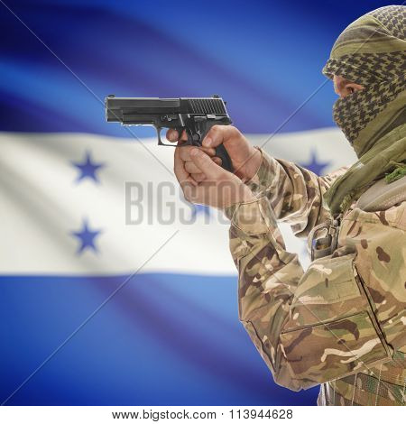 Male In With Gun In Hand And National Flag On Background - Honduras