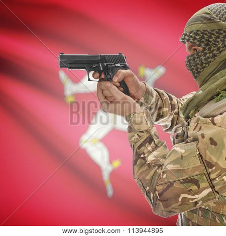 Male In With Gun In Hand And National Flag On Background - Isle Of Man