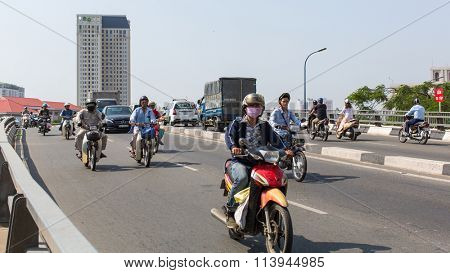 HO CHI MINH, VIETNAM - JAN 11, 2015: Motorcycle traffic in Ho Chi Minh city. Is located in the South of Vietnam, is the country's largest city, population 8 million.